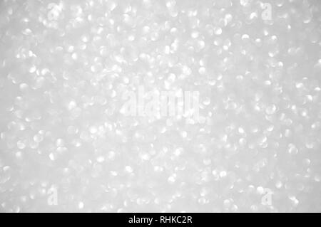 Abstract of shining bokeh glitters for background with copy space. Christmas and New Year wallpaper decorations concept. - Stock Photo