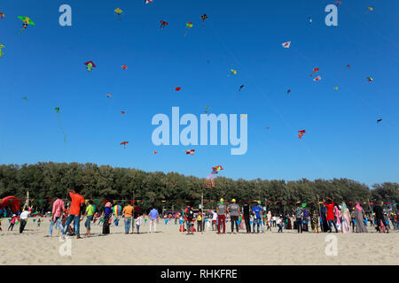 Cox's bazar, Bangladesh - February 01, 2019: Participants, mostly youths, flying kites of various colures and varieties during a Traditional kite fest - Stock Photo