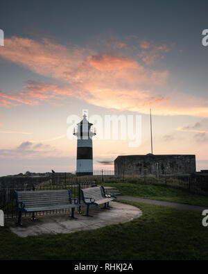 Southsea castle sunrise with benches in foreground, Southsea, Portsmouth, Hampshire, UK - Stock Photo