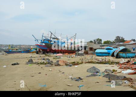Mui Ne, Vietnam - December 27 2017. Traditional wooden and round fishing boats at Mui Ne Fishing Village. Despite being a major tourist attraction in  - Stock Photo