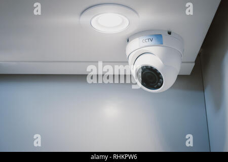 CCTV security camera on wall in the home office for surveillance monitoring home guard system. - Stock Photo