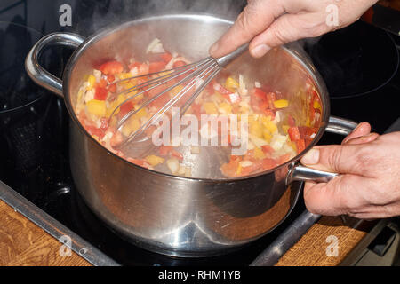 Ratatouille prepared from tomatoes, onions, paprika noodles, garlic and cheese - Stock Photo