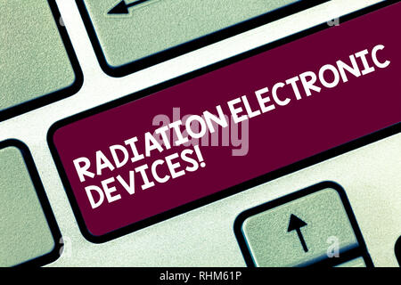 Text sign showing Radiation Electronic Devices. Conceptual photo radio frequency emitted by electronic devices Keyboard key Intention to create comput - Stock Photo