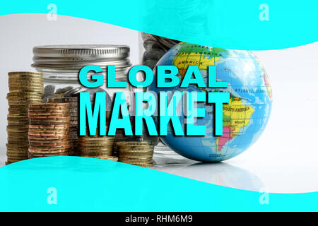 Global economy financial concept with sphere globe,stacked of coins and inscription of GLOBAL MARKET. - Stock Photo
