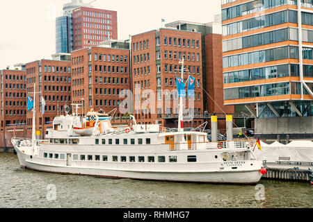 Hamburg, Germany - September 07, 2017: Water travel, travelling, trip. Ship at ferry pier on cityscape background. River transport transportation Vacation discovery wanderlust - Stock Photo