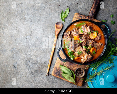 Beef ribs Bourguignon. Beef ribs stewed with carrot, onion in red wine. France dish - Stock Photo