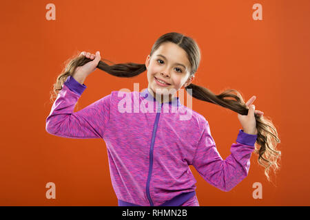Small girl child. Hairdresser for kids. childrens day. Portrait of happy little child. Kid fashion and sportswear. childhood happiness. Family. Happy little girl with long hair. Hello. - Stock Photo