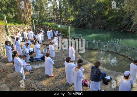 Israel, Yardenit Baptismal Site In the Lower Jordan River South of the Sea of Galilee, A group of pilgrims being Baptized - Stock Photo