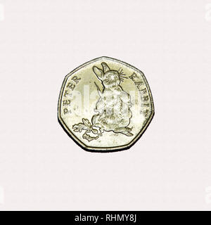 Limited edition British 50p piece coin commemorating Beatrix Potter character Peter Rabbit full figure eating carrots - Stock Photo