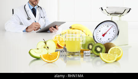 dietitian nutritionist doctor prescribes prescription by consulting the digital tablet sitting at the desk office with fruits, glass juice, tape meter - Stock Photo