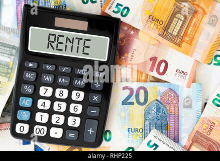 German word RENTE (pension) on display of pocket calculator against paper money - Stock Photo
