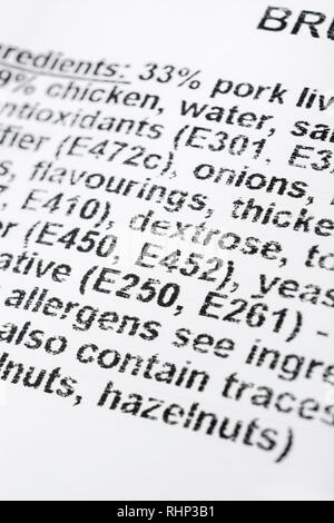 Macro close-up of food ingredient label of a ready-made Brussels Pate showing food additive E Numbers. - Stock Photo