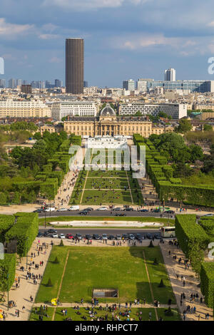 View from the Eiffel Tower at the Champ de Mars and the complex of buildings of the military school in Paris - Stock Photo