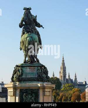 Equestrian statue of Prince Eugene of Savoy on Heldenplatz in Vienna, Austria with the City Hall in the background - Stock Photo