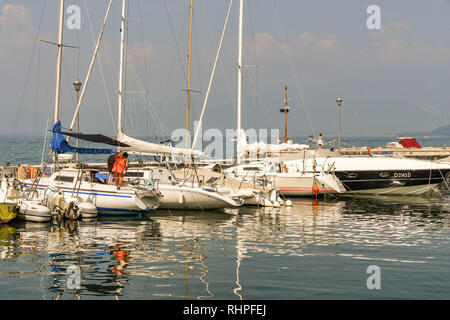 LAZISE, LAKE GARDA, ITALY - SEPTEMBER 2018: Boats and yachts in the harbour in Lazise on Lake Garda. - Stock Photo