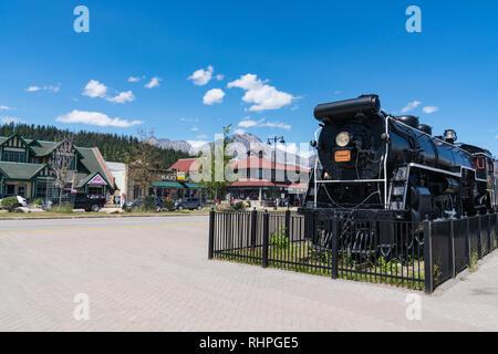 JASPER, CANADA - JULY 5, 2018: Old Canadian National Railroad locomotive in downtown Jasper, Alberta along Connaught Drive. - Stock Photo
