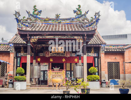 Temple of snakes with real snakes inside on the island of Penang, Malaysia - Stock Photo