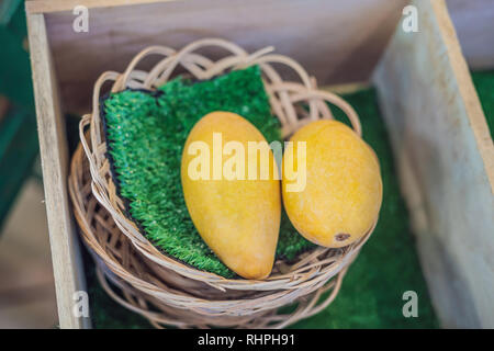 Yellow Mango on market - exotic thai fruits - Stock Photo