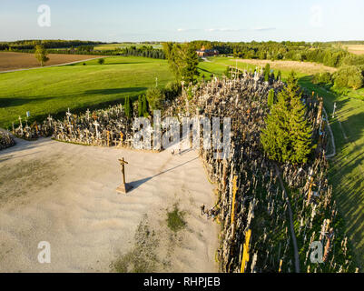 Aerial view of Kryziu kalnas, or the Hill of Crosses, a site of pilgrimage near the city of Siauliai, in northern Lithuania. Sunny summer evening. - Stock Photo