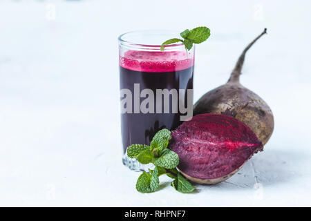 fresh juice from homemade vegetables. Beet smoothie. Detox, vegetarianism On a bright summer background Copy space - Stock Photo