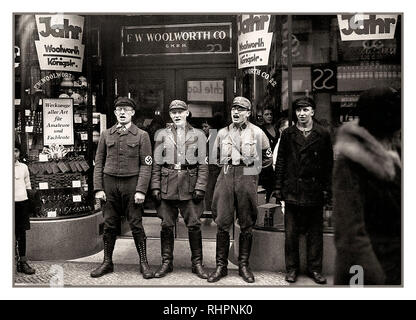 1930's anti-Jewish Nazis and NSDAP party members indulge in racist anti Jewish chanting, at entrance to German high street Woolworth store, to promote a boycott of the allegedly Jewish-founded Woolworths Germany 1933. - Stock Photo