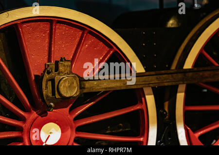 Details of bright red wheels, fragment of old locomotive closeup. Absract vintage background - Stock Photo
