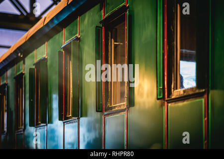Carriage of an old-fashioned train closeup. Absract vintage background - Stock Photo