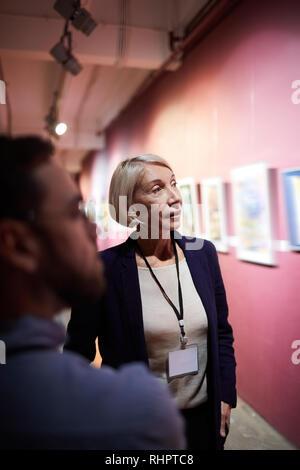Art Gallery Curator in Museum - Stock Photo