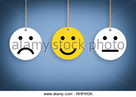 Unhappy and Happy on Blue Background - Stock Photo