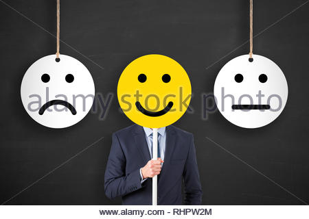 Unhappy and Happy on Chalkboard Background - Stock Photo