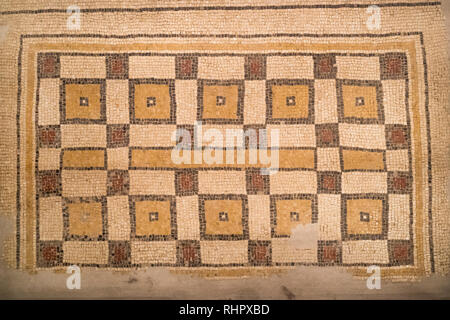 Ancient byzantine natural stone tile mosaics with with geometric patterns, Mount Nebo, Jordan, Middle East. - Stock Photo