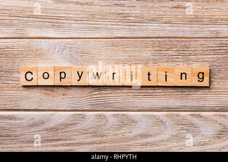 Copywriting word written on wood block. Copywriting text on wooden table for your desing, concept. - Stock Photo