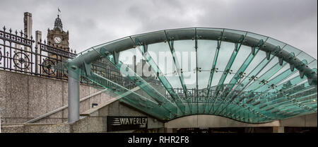 Waverley Station's imposing glass and steel canopy covers the Mall Entrance into Waverley Station in Scotland's famous bustling City of Edinburgh - Stock Photo