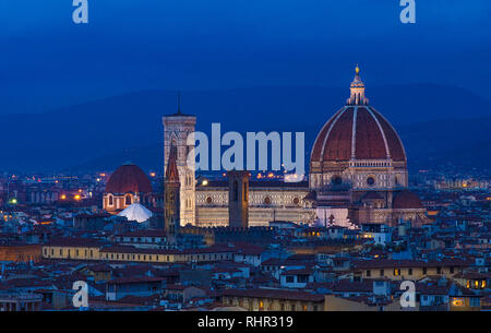 The Duomo in Florence, the Cathedral of Santa Maria del Fiore with beautiful lights from the top at night after sunset in Florence, Italy - Stock Photo