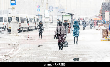 Blizzard in an Urban Environment. Crowd of Rushing People in Snowfall. Abstract Blurry Winter Weather Background. - Stock Photo