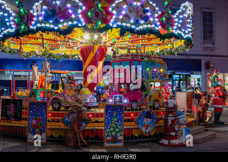 colorful merry go round at night - Stock Photo