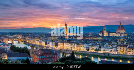 Night panorama of Florence in Italy from Piazza Michelangelo including the cathedral of Santa Maria del Fiore (Duomo), Palazzo Vecchio at sunset - Stock Photo