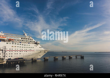 Beautiful blue skies and water behind the Carnival Inspiration Cruise Ship in Long Beach, California, USA - Stock Photo