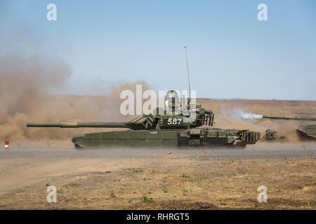 International military technical forum ARMY-2018. Russian modern T-90 tank is moving at the military training ground - Stock Photo