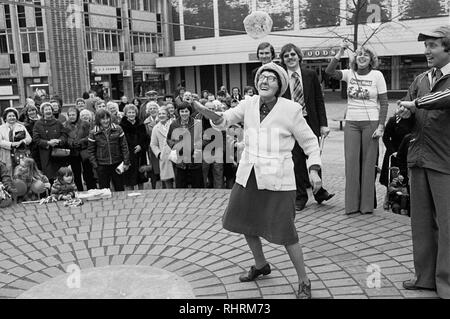 Pancake tossing competition, John Frost Square, Newport, South Wales, 1979. - Stock Photo