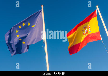 Eu and Spanish flags side by side. Europe Union flag. - Stock Photo