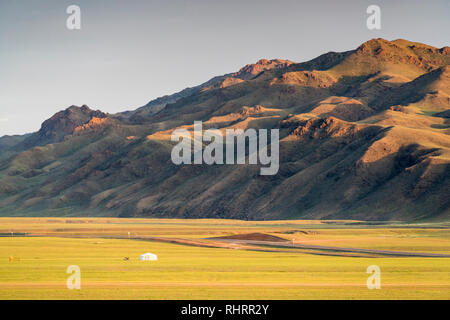 Nomadic ger and mountains in the background. Bayandalai district, South Gobi province, Mongolia. - Stock Photo