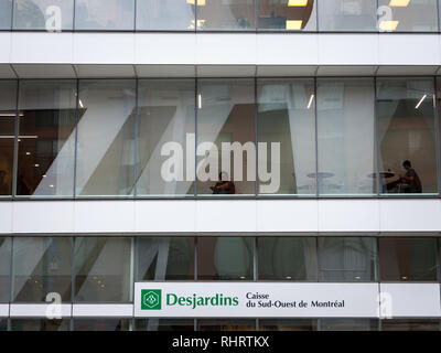 MONTREAL, CANADA - NOVEMBER 9, 2018: Desjardins Bank logo on their main branch for Montreal, Quebec. Mouvement Desjardins Banque is one of the main ba - Stock Photo