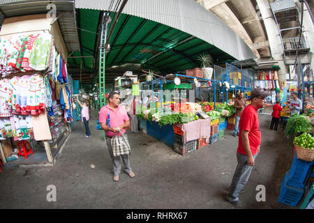 Caracas, Dtto Capital / Venezuela - 04-02-2012 :  People buying in a famous popular market in San Martín Avenue. - Stock Photo
