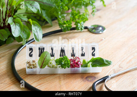 Vegetable sprouts and herbs in the box healthy life style and alternative medicine concept - Stock Photo