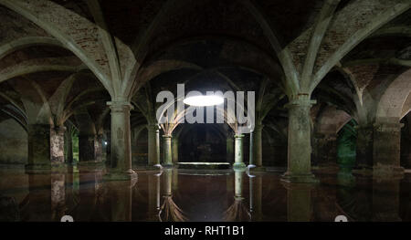 Inside interior of the old Manueline Cistern reflection. Sunlight beam in darkness, dark room ground floor in Portuguese Cisterns. El Jadida Morocco - Stock Photo