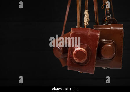 Group of retro cameras in covers. Collecting of antiques, auction theme