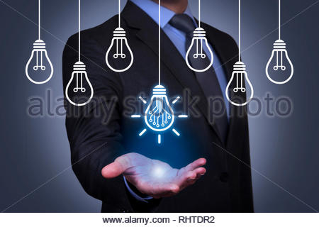 Innovation Concepts with Light Bulb on Visual Screen - Stock Photo