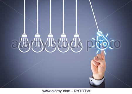 Ideas Solution Concepts with Light Bulb on Visual Screen - Stock Photo