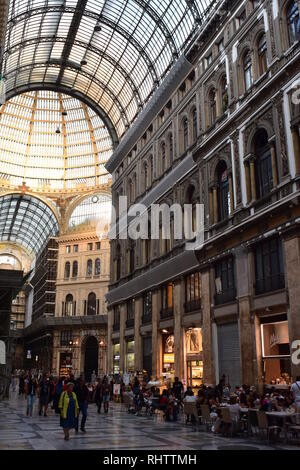 Street life around cafes and restaurants in Galleria Umberto in Naples. - Stock Photo